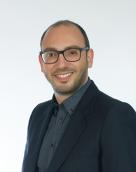 associate Andreas Christodoulou