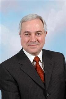 associate Δημήτρης Καραγιάννης
