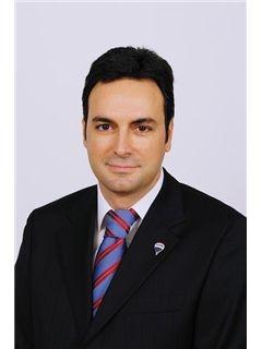 associate Κωνσταντίνος Κολοβός