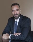 associate Στέλιος Σαμολαδάς