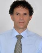 associate Nikolaos Tomadakis